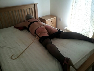 Tied Up and Caned on the Bed
