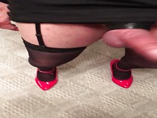 2 crossdressers kiss and play with cocks
