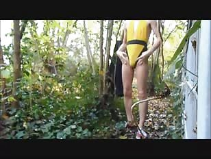 Outdoor Walk in a Yellow Swimsuit