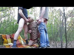 Amateur Crossdresser Enjoys Threesome Sex in the Woods