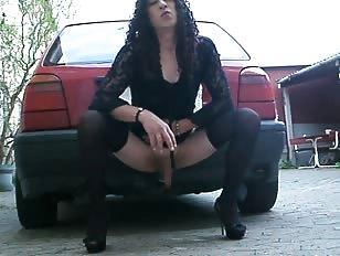 Naughty Crossdresser Riding a Car Hitch